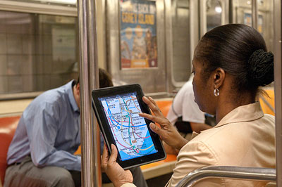 Photo of subway rider using an MTA app