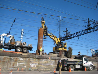 Steel casing being installed for new catenary foundation in Bridgeport, CT.