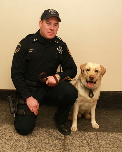 MTA PD Officer Daniel McDade and his canine partner, Reno.