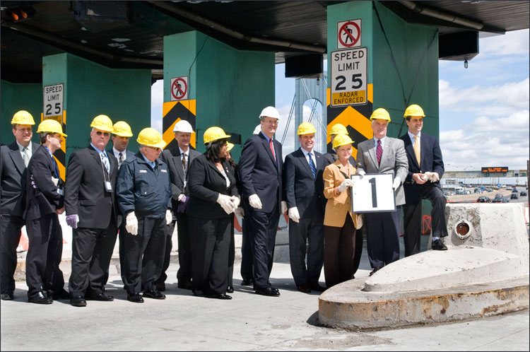 (r to l) State Sen. Andrew Lanza, U.S. Rep. Michael McMahon and State Assemblywoman Janele Hyer-Spencer (holding toll booth #1 sign), Assemblyman Michael Cusick, MTA Chairman Jay Walder, City Councilwoman Debi Rose, Staten Island Borough President James Molinaro, and MTA officials.
