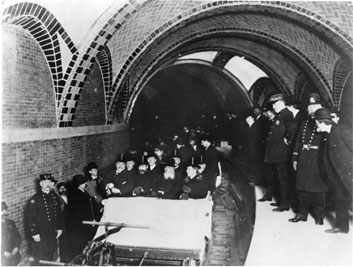 Photo of City officials on inspection tour of City Hall station and tracks as they near completion, January 1, 1904.