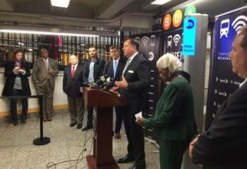 Transit Wireless CEO Bill Bayne is joined by MTA and other technology officials to announce WiFi at Bronx subway stations