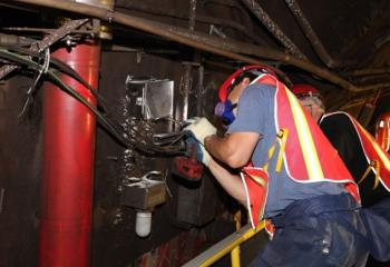 Maintainers Installing Junction Box Inside Greenpoint Tube