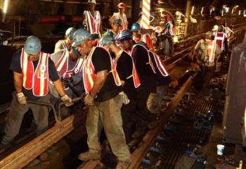Track Workers Carry New Rail Into Place Inside Greenpoint Tube