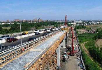 Traffic flowing while wider roadway lanes constructed