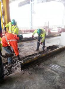 Crews removing steel curb