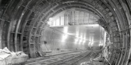 Sandhogs pose as two tunneling shields meet. The shields pushed through the soft soil under the river and supported the tunnels until the permanent structures of the tunnel (in this case cast iron rings) were put into place.   Photographer by J. Stock for Voss Studios November 21, 1939