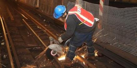 Track member cuts rail to be loaded onto rail car during track work at 14th St. and Union Sq. station along the 4 and 5 lines.