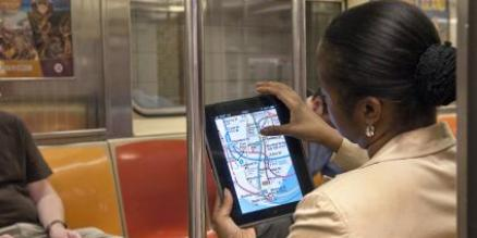 Woman uses iPad in subway